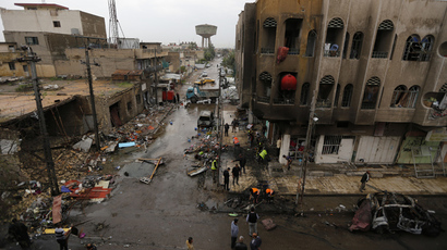 A general view of the site of a car bomb attack in the neighbourhood of al-Qahera is seen in northern Baghdad, March 9, 2014 (Reuters / Thaier al-Sudani)