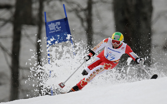 Canada's Matt Hallat skis during the men's standing skiing Super G at the 2014 Sochi Paralympic Winter Games at the Rosa Khutor Alpine Center March 9, 2014 (Reuters / Christian Hartmann)