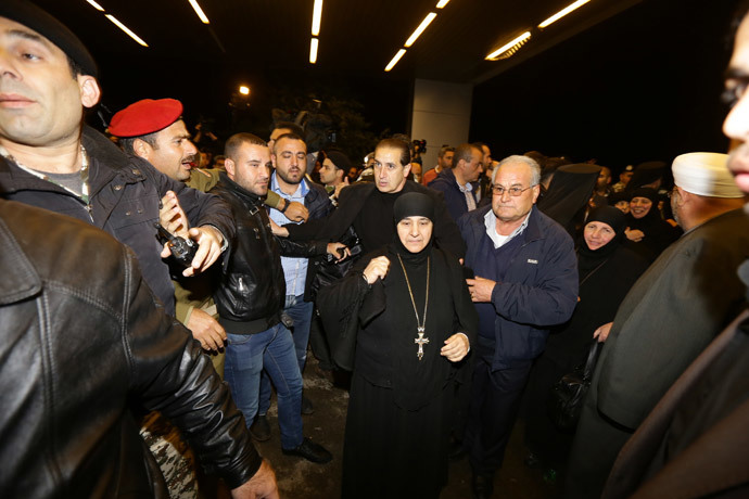 Kidnapped nuns arrive at Jdeidet Yabus on the Syrian side of the border with Lebanon after an arduous nine-hour journey that took them from Yabrud into Lebanon, and then back into Syria on March 10, 2014.( AFP Photo / Louai Beshara)