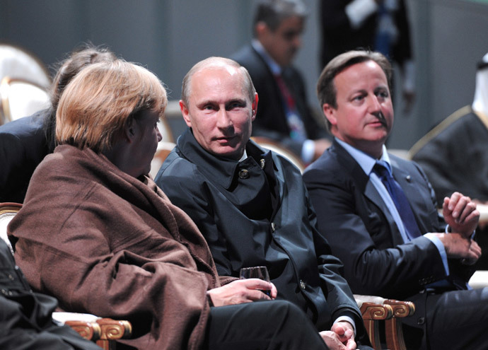 """German Chancellor Angela Merkel, Russia's President Vladimir Putin and Britain's Prime Minister David Cameron (L-R) sit to watch a fragment of the ballet """"Ruslan and Lyudmila"""" during the G20 Summit in Peterhof near St. Petersburg September 6, 2013.(Reuters / Michael Klimentyev)"""