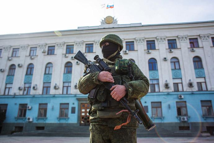A soldier outside the Crimean legislature building in Simferopol. (RIA Novosti/Andrey Stenin)