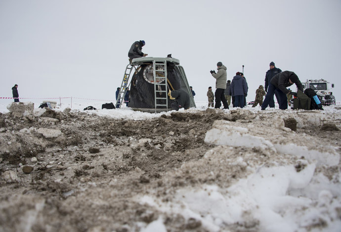 The Soyuz TMA-10M capsule is seen shortly after it landed with former ISS commander Oleg Kotov and flight engineers Sergei Ryazansky and Michael Hopkins from NASA onboard in a remote area southeast of the town of Zhezkazgan in central Kazakhstan, March 11, 2014. (Reuters / Bill Ingalls / NASA / Handout via Reuters)