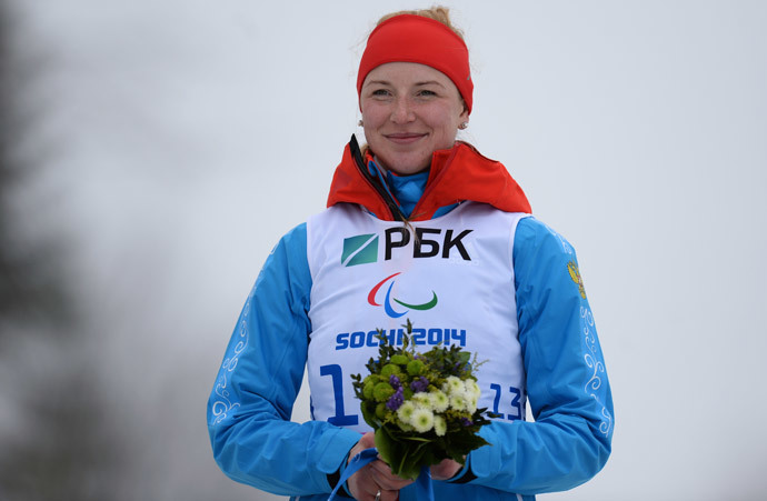 Russia's Alena Kaufman after winning gold in the women's 10 kilometers standing event at the Sochi Paralympics. (RIA Novosti / Maxim Bogodvid)