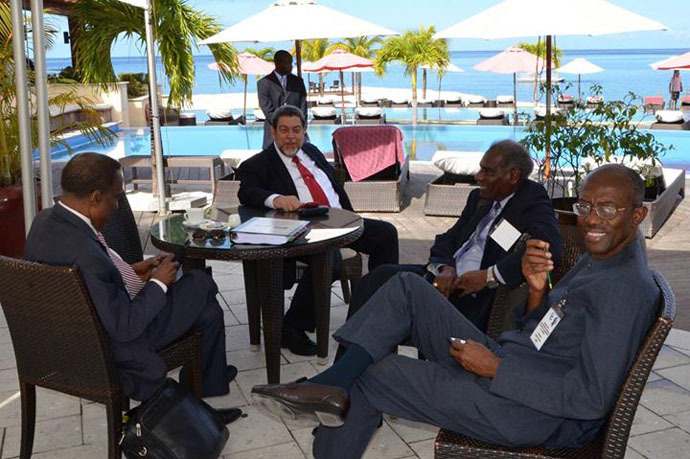 CARICOM Chairman Ralph Gonsalves (second left), with two of the Action Plan's backers, (r) Professor Andrew Downes and Professor Vaughan Lewis, and Sir Edwin Carrington Trinidad and Tobago's Ambassador to CARICOM. (Photo from facebook.com/cc.secretariat)