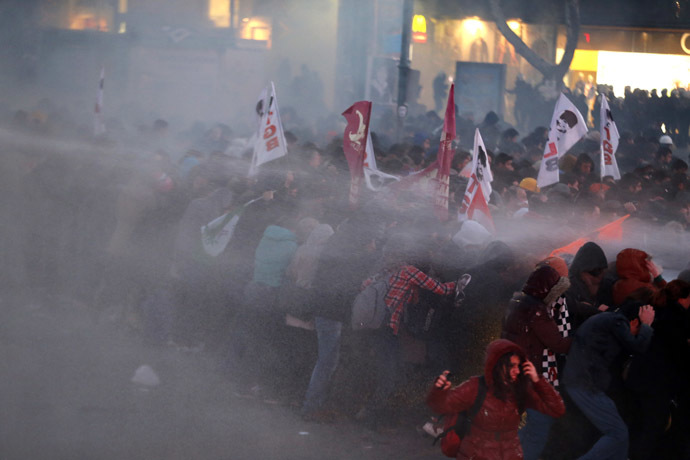 Anti-government protesters run as riot police fires a water cannon during a demonstration in Ankara March 11, 2014. (Reuters)