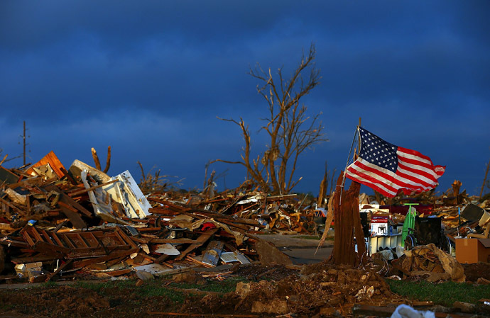 The sun rises over a tornado ravaged home early on May 27, 2013 in Moore, Oklahoma. (Tom Pennington/Getty Images/AFP)