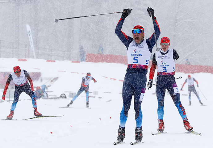 Russia's Kirill Mikhaylov celebrates his gold medal win during the men's 1 km sprint cross-country standing at the 2014 Sochi Paralympic Winter Games in Rosa Khutor, March 12, 2014 (Reuters / Alexander Demianchuk)