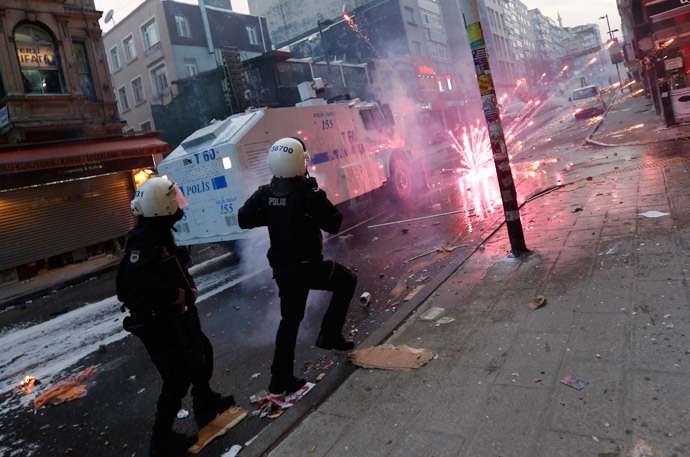 Fireworks thrown by anti-government protesters explode near riot policemen during a demonstration in Istanbul March 12, 2014. (Reuters / Murad Sezer )
