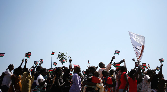 People wave South Sudanese flags as they celebrate referendum results in town of Abyei October 31, 2013.(Reuters / Goran Tomasevic)