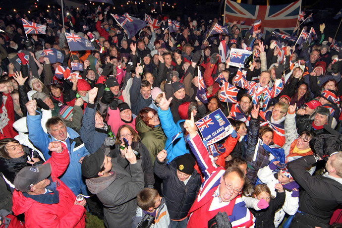 Islanders celebrate after the annouce of the referendum's result in Port Stanley, Falkland (Malvinas for Argentina) Islands, on March 11, 2013.(AFP Photo / Tony Chater)