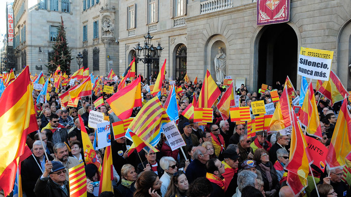 Catalans against the region's independence hold a Spanish flag during a demonstration for the unity of Spain and against the independence of Catalonia marking the Spanish constitution Day in Barcelona on December 6, 2013.(AFP Photo/ Josep Lago)