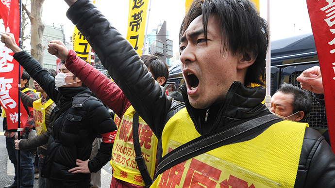 Fukushima nuclear workers stage low pay protest against Tepco