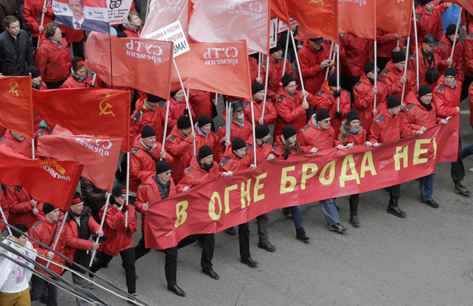 "People participate in the ""Brotherhood and Civil Resistance March"" in Moscow March 15, 2014. (Reuters/Tatyana Makeyeva)"