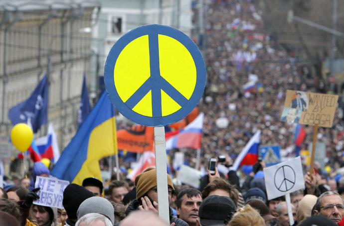 People take part in an anti-war procession and a rally in Moscow March 15, 2014. (Reuters/Maxim Shemetov)