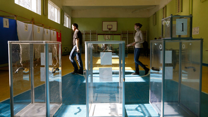 Election commission officials take part in the preparations for a referendum at the polling station in the Crimean town of Simferopol March 15, 2014. (Reuters / Vasily Fedosenko)