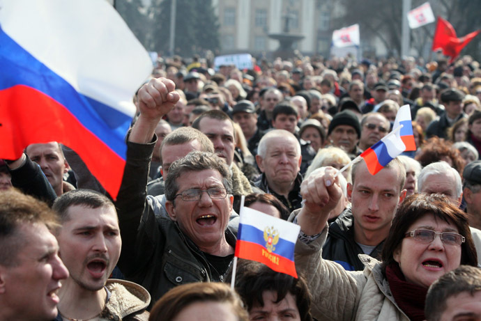 Pro-Russian activists hold Russian national flags during a demonstration rally in the center of the eastern Ukrainian city of Donetsk on March 15, 2014. (AFP Photo)