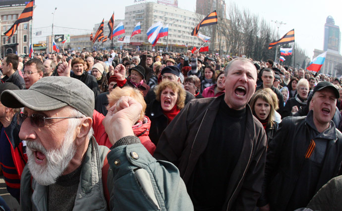 Pro-Russian activists shout slogans and hold Russian national flags during a demonstration rally in the center of the eastern Ukrainian city of Donetsk on March 15, 2014. (AFP Photo)