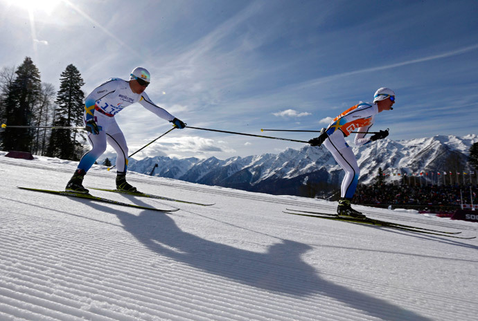 Sweden's Zebastian Modin (L) and his guide Albin Ackerot ski during the men's 10 km cross-country for the visually impaired at the 2014 Sochi Paralympic Winter Games in Rosa Khutor, March 16, 2014. (Reuters / Alexander Demianchuk)