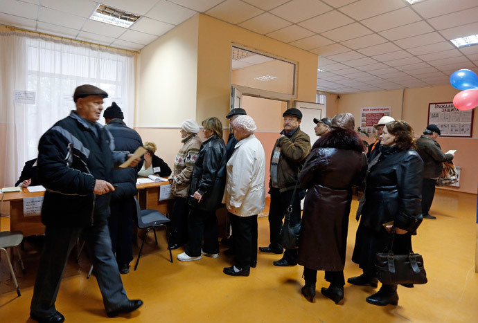 People line up to receive their ballots during the referendum on the status of Ukraine's Crimea region at a polling station in Simferopol March 16, 2014. (Reuters / Vasily Fedosenko)