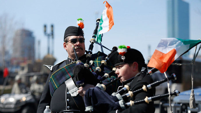 Members of the Quaboag Highlanders Pipes and Drums prepare to march down Broadway during the annual South Boston St. Patrick's Day parade in Boston, Massachusetts March 16, 2014..(Reuters / Dominick Reuter)