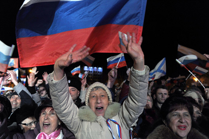 Pro-Russian Crimeans celebrate in Sevastopol on March 16, 2014 after partial showed that about 95.5 percent of voters in Ukraine's Crimea region supported union with Russia.(AFP Photo / Viktor Drachev)