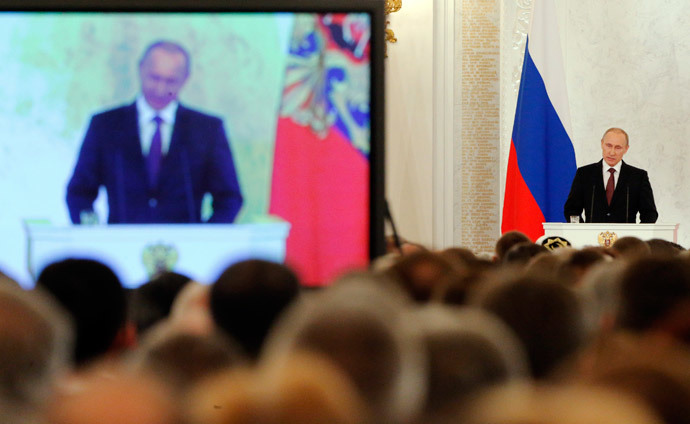 Russian President Vladimir Putin addresses the Federal Assembly, including State Duma deputies, members of the Federation Council, regional governors and civil society representatives, at the Kremlin in Moscow March 18, 2014. (Reuters / Maxim Shemetov)