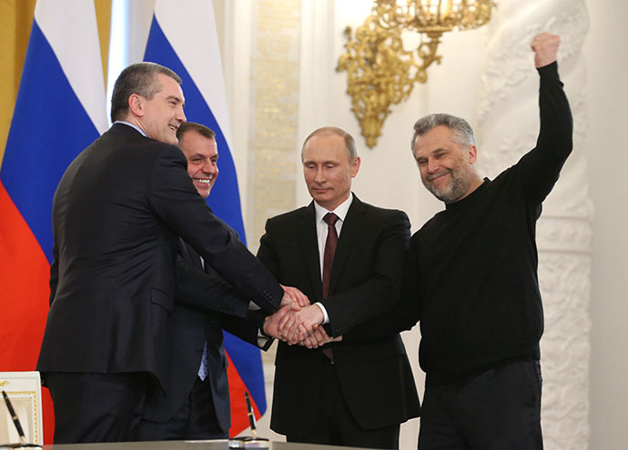 President Vladimir Putin (second right) attending the Kremlin ceremony on signing the Russian Federation-Crimea Treaty on Crimea's integration with Russia and formation of new jurisdictions in the Russian Federation, March 18, 2014. From left: Sergei Aksyonov, Prime Minister of the Autonomous Republic of Crimea, and Vladimir Konstantinov, Chairman of Crimea's Supreme Council. Right: Aleksei Chaly, head of Sevastopol. (RIA Novosti / Ekaterina Shtukina)