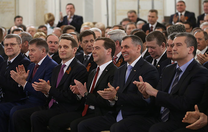 Dmitry Medvedev (third right, foreground), listening to President Vladimir Putin's statement before the assembly of Duma deputies, Federation Council members, the heads of the Russian regions and representatives of civil society. His speech concerned an appeal by the Republic of Crimea and the city of Sevastopol to integrate them with the Russian Federation, March 18, 2014. (RIA Novosti / Ekaterina Shtukina)
