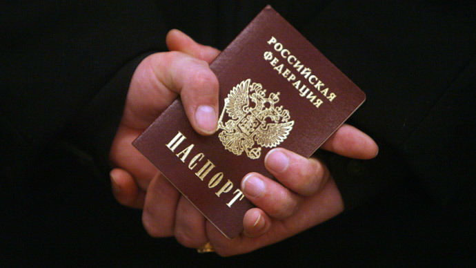 First passports handed out to new Russian citizens in Crimea