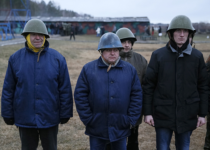 "Members of a ""Maidan"" self-defense battalion take part in weapons training at a Ukrainian Interior Ministry base near Kiev March 17, 2014. (Reuters / Gleb Garanich)"