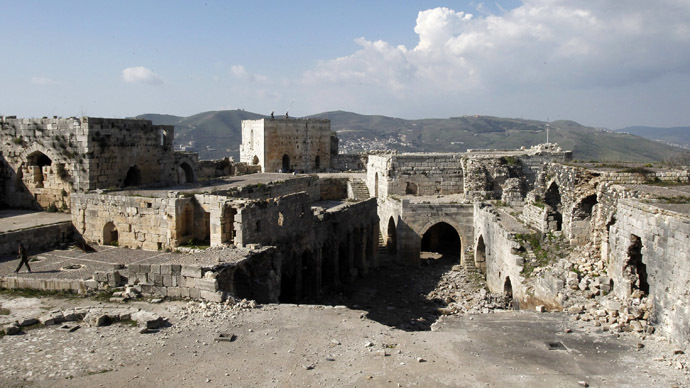 A view shows the damage inside the Crac des Chevaliers fortress in the Homs countryside, after soldiers loyal to Syria's President Bashar al-Assad took control of it from rebel fighters, March 21, 2014. (Reuters/Khaled al-Hariri)