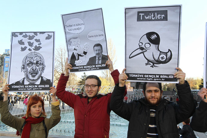 People hold placards as they protest against Turkey's Prime Minister Tayyip Erdogan after the government blocked access to Twitter in Ankara, on March 21, 2014. (AFP Photo/Adem Altan)