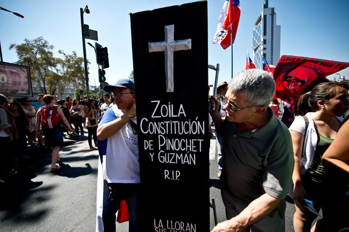 People take part in a protest to demand free and good quality education and a call for a Constituent Assembly, in Santiago, on March 22, 2014. (AFP Photo / Martin Bernetti)