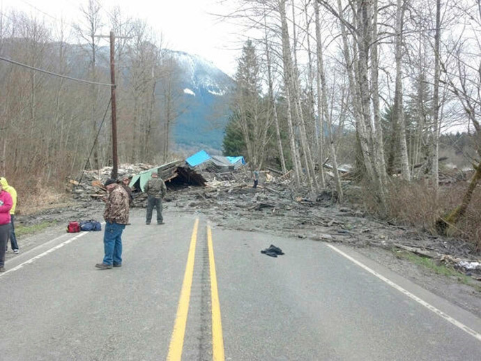 Officials survey a large mudslide in this handout photo provided by the Washington State Police near Oso, Washington March 22, 2014. (Reuters / Washington State Police / Handout via Reuters)