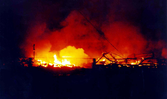A police training centre in Novi Sad, in the north of Yugoslavia burns 25 March 1999 after it was destroyed during NATO air strikes, according to the official Yugoslav news agency, Tanjug (AFP Photo)