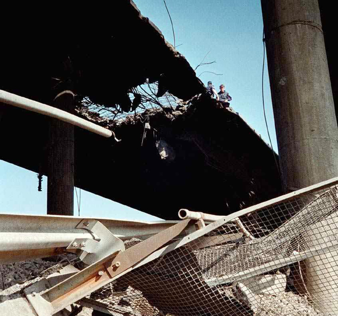 Photo released 11 May 1999 by the official Yugoslav news agency, Tanjug shows a view of a bridge on the Belgrade-Nis highway, 90 km south of Belgrade which was reportedly damaged during NATO air strikes the night before (AFP Photo)
