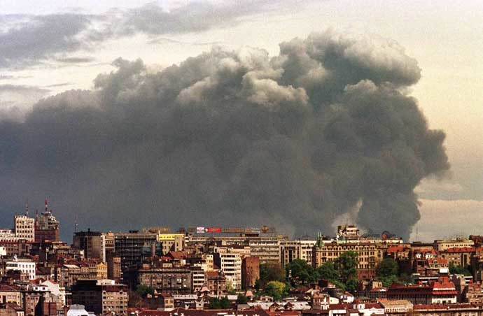 Smoke looms over Belgrade from the Pancevo chemical plant after NATO air strike April 18. (Reuters)