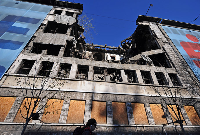 A woman walks in front of the former federal Interior Ministry in Belgrade, destroyed by NATO March 22, 2014. (AFP Photo)