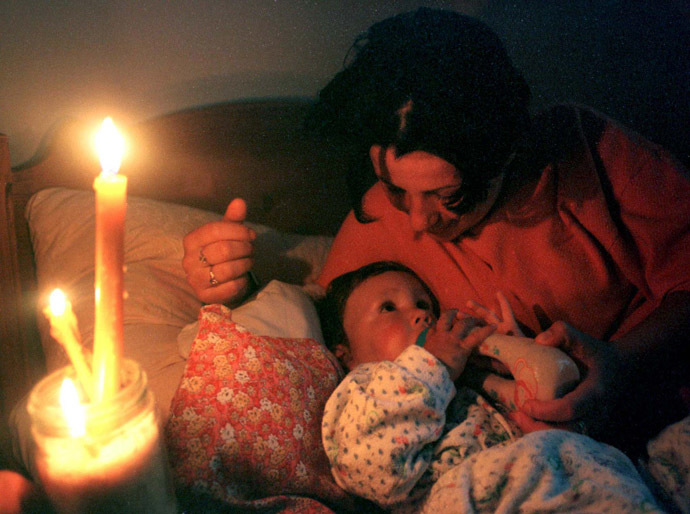 A woman feeds her baby in a Belgrade bomb shelter after air raid sirens went of May 8. (Reuters)