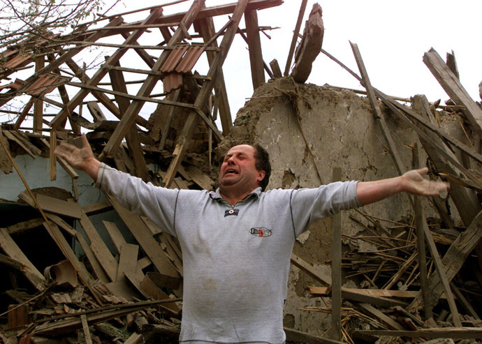 A man in front of his house after a daylight May 7 NATO raid over Nis. (Reuters)