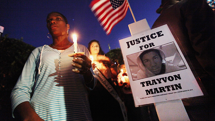 Supporters gather during a candelight vigil at a memorial to Trayvon Martin outside The Retreat at Twin Lakes community where Trayvon was shot and killed by George Michael Zimmerman while on neighborhood watch patrol on March 25, 2012 in Sanford, Florida. (AFP Photo / Mario Tama)