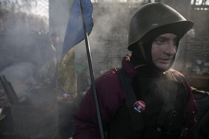A member of the Right Sector movement guards a barricade in central Kiev (Reuters / Baz Ratner)