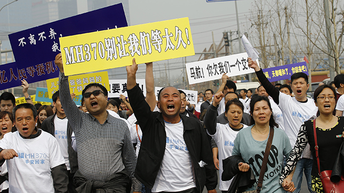 'Have you no shame?'  Grief-stricken families of MH370 passengers protest in China