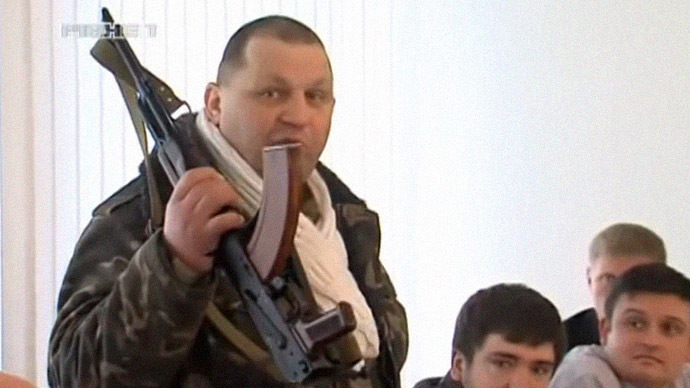 Ukrainian nationalist Muzychko armed with AK-47 threatens Rovno regional parliament on February 26, 2014.