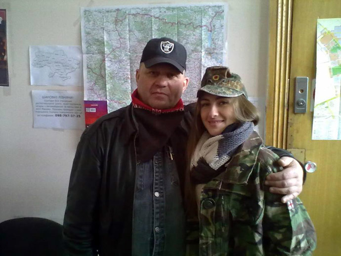 Right Sector coordinator Aleksandr Muzychko posing with a young member of nationalist organization.