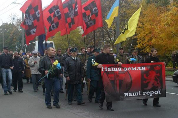Parade of Ukrainian nationalists with veterans of Nazi units and Aleksandr Muzychko (L)