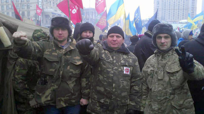 Aleksandr Muzychko (C) with members of the Right Sector group on Kiev's Independence Square.