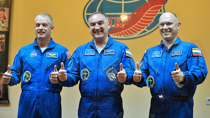 From left: NASA astronaut Steven Swanson and Roscosmos cosmonauts Alexander Skvortsov and Oleg Artemyev, crew members of the latest mission to the International Space Station (ISS), during a press conference ahead of the launch of the Soyuz-FG with the transport manned spacecraft (TPK) Soyuz TMA-12M at the Baikonur cosmodrome on March 24, 2013. (RIA Novosti / Ramil Sitdikov)