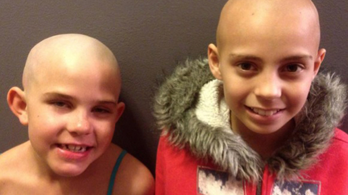 School reverses suspension of student who shaved her head for friend with cancer