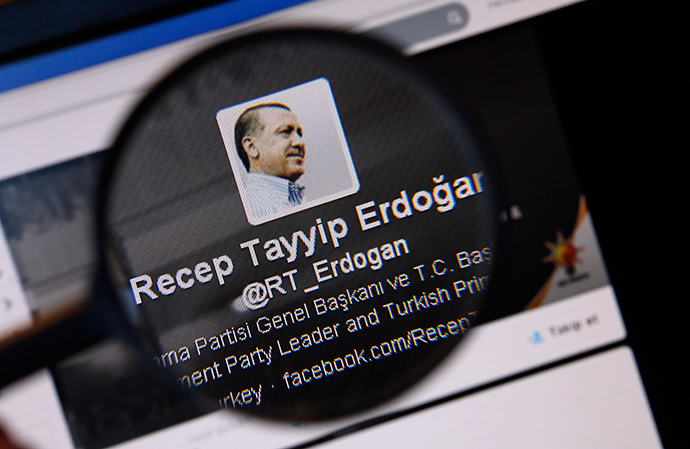 An image of Turkish Prime Minister Tayyip Erdogan on a twitter account is pictured through a magnifying glass in this illustration picture taken in Istanbul March 21, 2014 (Reuters / Murad Sezer)